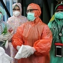 Medical workers wearing disposable raincoats as their protective suits to serve patients are pictured amid the spread of coronavirus disease (COVID-19) outbreak at a local health center in Aceh, Indonesia, April 6, 2020 in this photo taken by Antara Foto. Picture taken April 6, 2020. Antara Foto/Irwansyah Putra/ via REUTERS TPX IMAGES OF THE DAY ATTENTION EDITORS - THIS IMAGE WAS PROVIDED BY A THIRD PARTY. MANDATORY CREDIT. INDONESIA OUT.