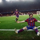 FILE PHOTO: ON THIS DAY -- April 6 April 6, 2010 SOCCER - Barcelona's Lionel Messi celebrates after scoring one of his four goals against Arsenal during their Champions League quarter-final second-leg match at the Nou Camp, Barcelona. Four years after being left out of the Barcelona side that beat Arsenal in the 2006 final, Messi tormented the London club, scoring all four goals in a 4-1 win and overtaking Rivaldo as Barcelona's all-time top scorer in the competition. Messi ended the season with 47 goals in all competitions, helping Barcelona retain their La Liga title, but his team were beaten by eventual champions Inter Milan in the Champions League semi-finals. REUTERS/Albert Gea/File Photo