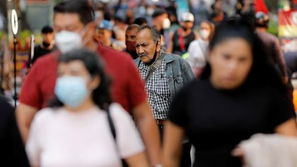 FILE PHOTO: People walk on the street, as the coronavirus disease (COVID-19) outbreak continues, in Mexico City, Mexico October 8, 2020. REUTERS/Carlos Jasso/File Photo