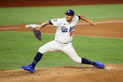 Oct 21, 2020; Arlington, Texas, USA; Los Angeles Dodgers starting pitcher Victor Gonzalez (81) delivers a pitch in the 3rd inning against the Tampa Bay Rays in game two of the 2020 World Series at Globe Life Field. Mandatory Credit: Tim Heitman-USA TODAY Sports