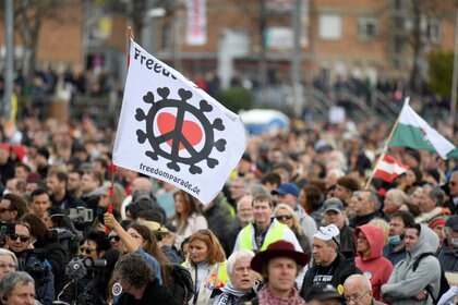 Demonstrators attend a protest against the government's coronavirus disease (COVID-19) restrictions in Stuttgart, Germany, April 3, 2021. REUTERS/Andreas Gebert