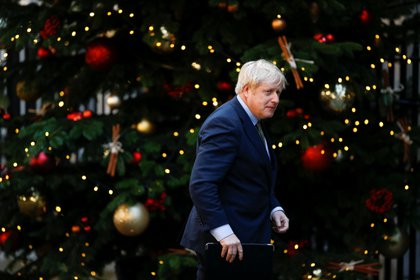 Britain's Prime Minister Boris Johnson walks outside Downing Street during his statement after winning the general election, in London, Britain, December 13, 2019. REUTERS/Henry Nicholls
