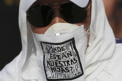 """A demonstrator wearing a mask against the spread of the new coronavirus that has a message that reads in Spanish """"Where are our dauthers?"""" participates in a protest by mothers of missing children in Mexico City, Sunday, May 10, 2020. (AP Photo/Fernando Llano)"""