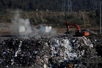 FILE PHOTO: Trucks with garbage are seen at a landfill in Sobrado Portugal, January 8, 2020. Picture taken on January 8, 2020. REUTERS/Rafael Marchante/File Photo