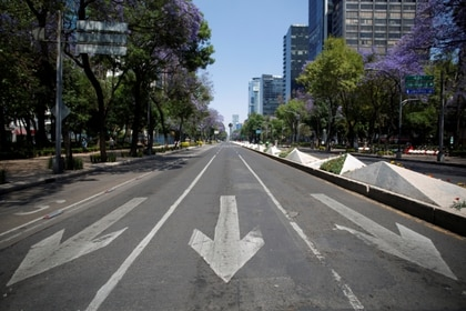 An empty road is pictured as the coronavirus disease (COVID-19) outbreak continues, in Mexico City, Mexico March 22, 2020. REUTERS/Gustavo Graf