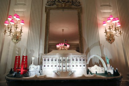 WASHINGTON, DC - DECEMBER 02: A miniature Golden Gate Bridge and St. Louis Gateway Arch stand next to a Ginger Bread White House in the State Dining Room at the White House December 2, 2019 in Washington, DC. The White House expects to host 100 open houses and more than 30,000 guests who will tour the topiary trees, architectural models of major U.S. cities, the Gold Star family tree and national monuments in gingerbread.   Mark Wilson/Getty Images/AFP