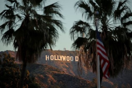 FILE PHOTO: Morning sun rise on the Hollywood sign in Los Angeles, California, U.S., February 6, 2020. REUTERS/Mike Blake/File photo