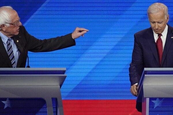 Sen. Bernie Sanders, I-Vt., left, speaks as former Vice President Joe Biden, right, listens Thursday, Sept. 12, 2019, during a Democratic presidential primary debate hosted by ABC at Texas Southern University in Houston. (AP Photo/David J. Phillip)
