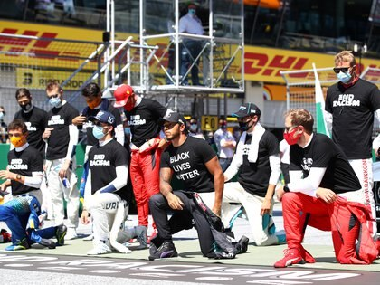 Formula One F1 - Austrian Grand Prix - Red Bull Ring, Spielberg, Styria, Austria - July 5, 2020   Mercedes' Lewis Hamilton on the grid kneels wearing an anti-racism T-shirt before the race   Mark Thompson/Pool via REUTERS