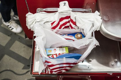 March 31, 2019 - New York, New York, United States: A person uses plastic shopping bags in a self pay station at Target store on Grand Street in New York. (Natan Dvir / Polaris Images)