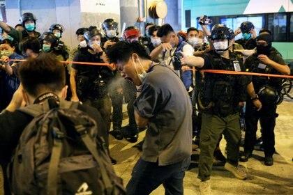 La policía reprimió las protestas (REUTERS/Tyrone Siu)