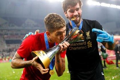 Liverpool Brazilians Firmino and Alison Becker celebrate after winning the Football Club World Cup, - Khalifa International Stadium, Doha, Qatar - December 21, 2019 REUTERS / Kai Pfaffenbach