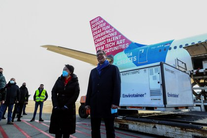 Aleksandar Vucic with China's ambassador to Serbia Chen Bo, as Serbia takes delivery of the Sinopharm vaccine in Belgrade, on Jan. 16. Photographer: Oliver Bunic/Bloomberg