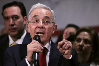 FILE PHOTO: Colombia's former president Alvaro Uribe, speaks during a news conference after a private hearing at Supreme Court of Justice, in Bogota, Colombia October 8, 2019. REUTERS/Luisa Gonzalez/File Photo
