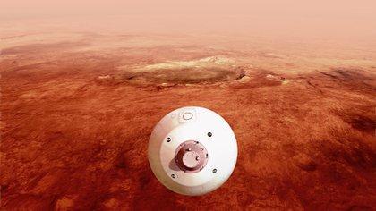 """Fotografía cedida este miércoles por la Administración Nacional de Aeronáutica y el Espacio (NASA) donde aparece una ilustración del """"aeroshell"""" que contiene el rover Perseverance mientras gira en preparación para un aterrizaje seguro sobre la superficie de Marte. El viaje de casi siete meses de la Tierra a Marte de la sonda espacial Perseverance terminará este jueves con un desafiante intento de aterrizaje en el planeta rojo que nadie podrá seguir en tiempo real por la diferencia de comunicaciones de 11 minutos entre ambos planetas. EFE/ Emma Howells/ NASA/ SOLO USO EDITORIAL/SOLO DISPONIBLE PARA ILUSTRAR LA NOTICIA QUE ACOMPAÑA (CRÉDITO OBLIGATORIO)"""