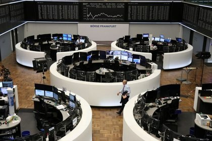 FILE PHOTO: The German share price index DAX graph is pictured at the stock exchange in Frankfurt, Germany, August 20, 2020. REUTERS/Staff