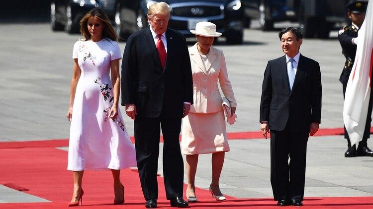 El encuentro entre el presidente de EEUU y el emperador japonés se produjo en el palacio imperial en Tokio (Photo by Brendan Smialowski / AFP)