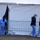 Healthcare workers are seen outside a newly constructed field hospital in the East Meadow of Central Park during the outbreak of the coronavirus disease (COVID-19) in the Manhattan borough of New York City, New York, U.S., April 1, 2020. REUTERS/Brendan Mcdermid