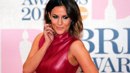 FILE PHOTO: Television presenter Caroline Flack arrives for the BRIT music awards at the O2 Arena in Greenwich, London, February 25, 2015. REUTERS/Suzanne Plunkett/File Photo