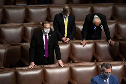 Representative Lee Zeldin, a Republican from New York, from left, Representative Jim Jordan, a Republican from Ohio, Representative Louie Gohmert, a Republican from Texas, and Senator Ted Cruz, a Republican from Texas, bow their heads in prayer during a joint session of Congress to count the Electoral College votes of the 2020 presidential election in the House Chamber in Washington, D.C., U.S., on Thursday, Jan. 7, 2021. U.S. House Majority Leader Steny Hoyer, a Democrat from Maryland, speaks during a joint session of Congress to count the Electoral College votes of the 2020 presidential election at the U.S. Capitol in Washington, D.C., U.S., on Wednesday, Jan. 6, 2021. The House and Senate resumed a politically charged debate over the legitimacy of the presidential election hours after a pro-Trump mob stormed the U.S. Capitol and drove lawmakers from their chambers. Photographer: Stefani Reynolds/Bloomberg