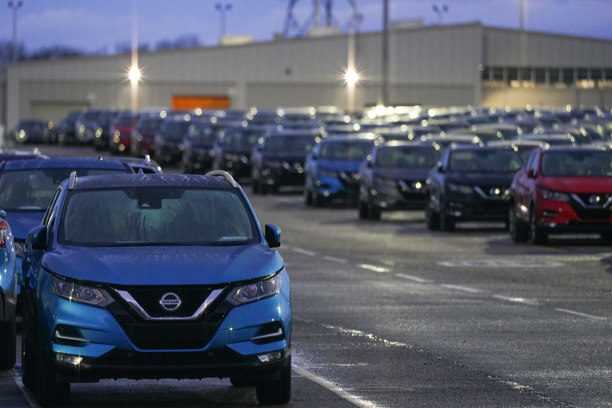 Newly manufactured automobiles parked at the Nissan Motor Co. plant in Sunderland, U.K., on Friday, Dec. 18, 2020. Nissan Motor Co. has opted to ship an upcoming electric vehicle to Europe from Japan rather than produce it in the U.K., where one of its largest factories faces existential risk from a hard Brexit.