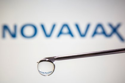 FILE PHOTO: A Novavax logo is reflected in a drop on a syringe needle in this illustration taken November 9, 2020. REUTERS/Dado Ruvic/Illustration/File Photo