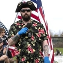 (FILES) In this file photo Matt Marshall of the right-wing group Washington State Three Percent (3%) speaks at a 'Hazardous Liberty! Defend the Constitution!' rally to protest the stay-at-home order, at the Capitol building on April 19, 2020 in Olympia, Washington. - Facebook has banned a