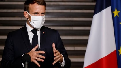 French President Emmanuel Macron wearing a face mask delivers a speech at the end of a visit about the fight against separatism at the Seine-Saint-Denis prefecture headquarters in Bobigny, near Paris, France October 20, 2020. Ludovic Marin/Pool via REUTERS