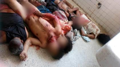 Los cuerpos de los presos masacrados apilados en la morgue de Portuguesa
