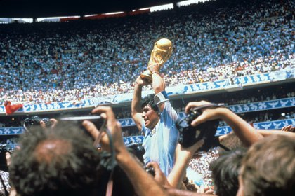 1986 file image of Argentine player Diego Armando Maradona with the World Cup after defeating the Argentine team against Germany by three goals to two, in the final played at the Azteca stadium in the Mexican capital. EFE / ra / Archive