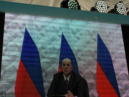 El primer ministro ruso, Mijail Mishustin, participó en la inauguración a través de una videoconferencia. (Dimitar DILKOFF / AFP)