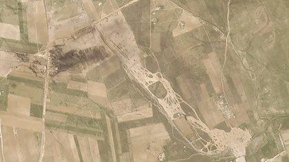 Los campos quemados en la zona atacada en la misma foto, tomada el 6 de marzo. (Planet Labs Inc. via AP)