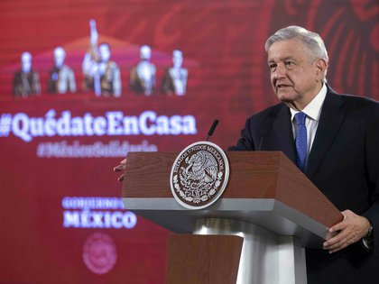Handout picture released by Mexico's Presidency press office showing Mexico's President Andres Manuel Lopez Obrador during his morning conference at the National Palace in Mexico City, on July 7, 2020. - Lopez Obrador informed Tuesday he tested negative for COVID-19, ahead of his official visit to the US to meet President Donald Trump. (Photo by - / Mexican Presidency / AFP) / RESTRICTED TO EDITORIAL USE - MANDATORY CREDIT AFP PHOTO / MEXICAN PRESIDENCY - NO MARKETING NO ADVERTISING CAMPAIGNS - DISTRIBUTED AS A SERVICE TO CLIENTS