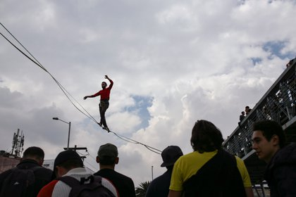 A man walks on a tightrope during a protest for a national strike, in Bogota, Colombia, November 21, 2019. REUTERS/Luisa Gonzalez