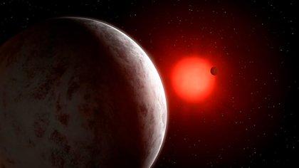 Recreación del sistema planetario en torno a la estrella Gliese 887 (Mark Garlick)
