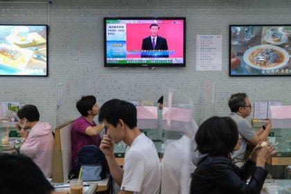 Una retransmisión en directo del discurso delpresidente Xi Jinpingen un restauranteenHong Kong (Bloomberg)