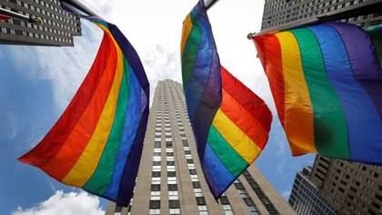 FILE PHOTO: Rainbow flags fly at Rockefeller Center in midtown Manhattan in support of the LGBT community, prior to the 51st anniversary of the Stonewall Uprising, in New York City, New York, U.S., June 26, 2020. REUTERS/Mike Segar/File Photo