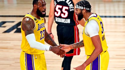 Sep 30, 2020; Orlando, Florida, USA; Los Angeles Lakers forward Anthony Davis (3) celebrates with forward LeBron James (23) after a play during the third quarter against the Miami Heat in game one of the 2020 NBA Finals at AdventHealth Arena. Mandatory Credit: Kim Klement-USA TODAY Sports