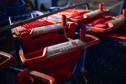 Shopping carts outside a Carrefour SA hypermarket in Avignon, France, on Friday, Jan. 15, 2021. Alimentation Couche-Tard Inc. plans to pump 3 billion euros ($3.6 billion) into Carrefour as the Canadian convenience-store operator seeks to defuse mounting French political concerns over the proposed $20 billion takeover of the French retailer. Photographer: Jeremy Suyker/Bloomberg