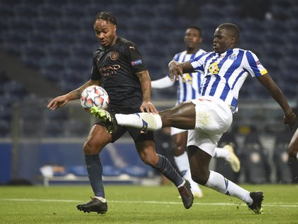 Soccer Football - Champions League - Group C - FC Porto v Manchester City - Estadio do Dragao, Porto, Portugal - December 1, 2020   Manchester City's Raheem Sterling in action with FC Porto's Malang Sarr Pool via REUTERS/Miguel Riopa
