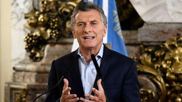 El Presidente en el Salón Blanco de Casa Rosada desde donde anunció hoy su plan de ajuste (Télam)