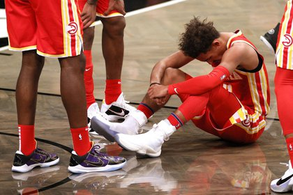 NEW YORK, NEW YORK - DECEMBER 30: Trae Young #11 of the Atlanta Hawks reacts during the second half against the Brooklyn Nets at Barclays Center on December 30, 2020 in the Brooklyn borough of New York City. The Nets won 145-141. NOTE TO USER: User expressly acknowledges and agrees that, by downloading and/or using this Photograph, user is consenting to the terms and conditions of the Getty Images License Agreement. (Photo by Sarah Stier/Getty Images)