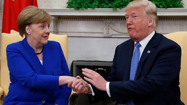 Angela Merkel junto a Donald Trump (Reuters)