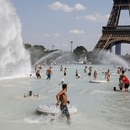 People cool off in the Trocadero fountains across from the Eiffel Tower in Paris as a heatwave hit much of the country, France, June 25, 2019. REUTERS/Charles Platiau