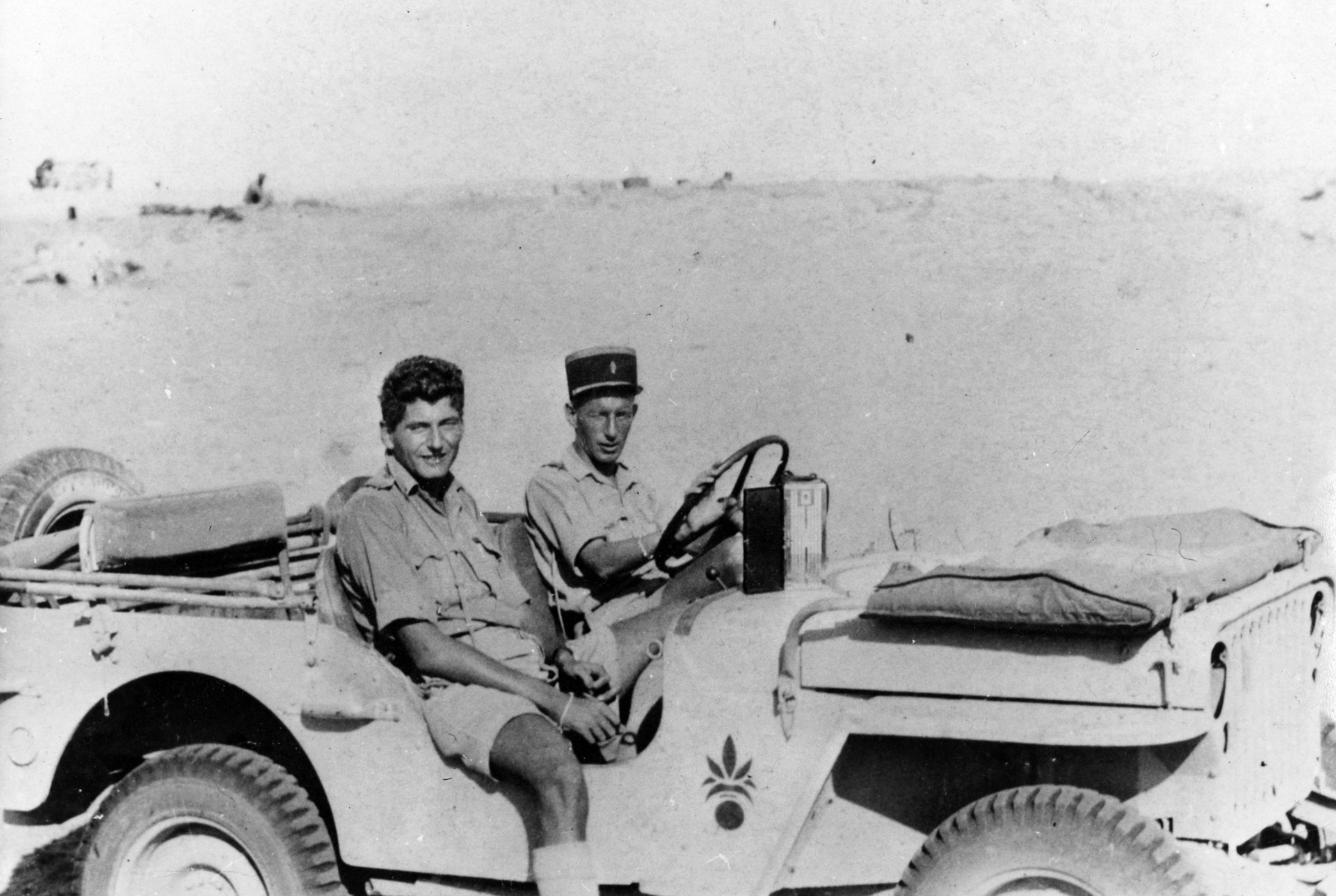 """(FILES) In this handout file picture released by the Musee de l'Ordre de la Liberation and  taken in 1942 in South El Alamein, at a place called """"Hell of the Stukas"""", shows French resistance member and Lieutenant Hubert Germain (L) and Captain Paul Arnault, both Companion of the Liberation. - Hubert Germain, who was the last surviving Liberation companion, died at the age of 101, French Defense Minister announced on October 12, 2021. (Photo by - / Mus�e de l�Ordre de la Lib�ration / AFP) / RESTRICTED TO EDITORIAL USE - MANDATORY CREDIT """"AFP PHOTO/ MUSEE DE L'ORDRE DE LA LIBERATION"""" - NO MARKETING - NO ADVERTISING CAMPAIGNS - DISTRIBUTED AS A SERVICE TO CLIENTS"""