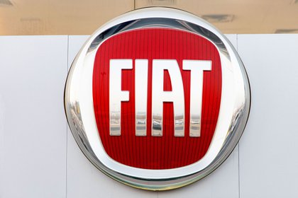 A Fiat Chrysler Automobiles NV badge sits on display at a National Auto showroom in Dubai, United Arab Emirates, on Thursday, Oct. 31, 2019. Fiat Chrysler Automobiles NV and PSA Group went out of their way to make their combination as equal as possible, shedding assets, paying special dividends and distributing board seats. It didn't take long for investors to figure out who the buyer is. Photographer: Christopher Pike/Bloomberg