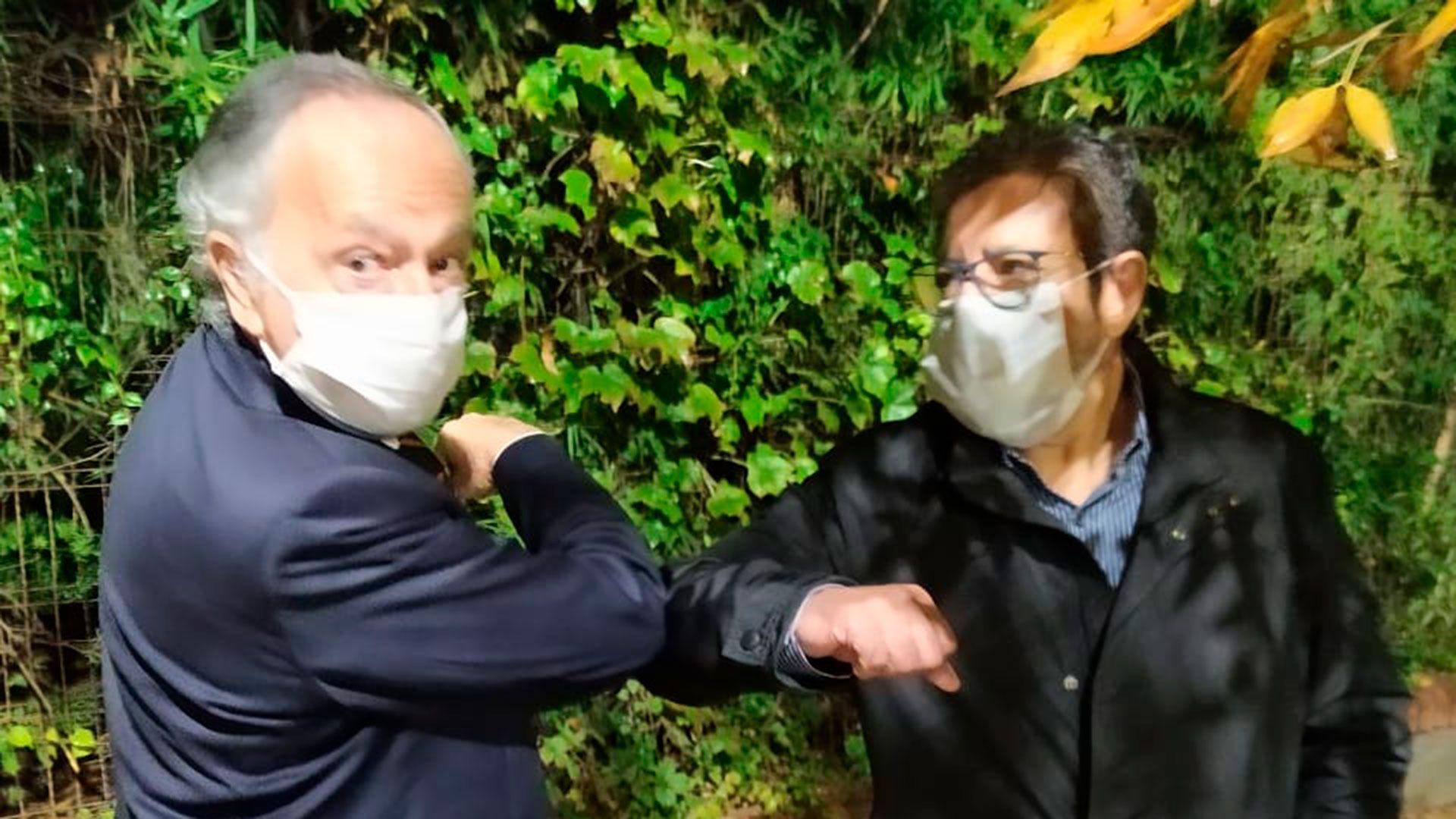Miguel Acevedo (UIA) y Gerardo Martínez (UOCRA), codo con codo, en la Quinta de Olivos