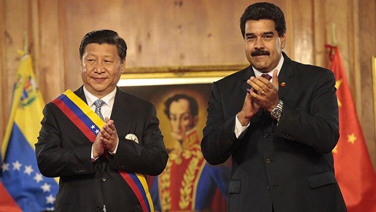 El presidente Xi Jinping y el dictador venezolano Nicolás Maduro, en Caracas, en 2017
