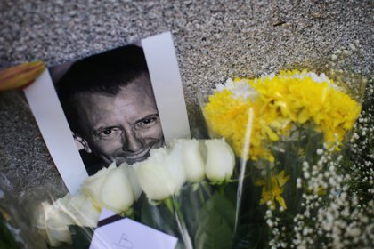 An image of French businessman Baptiste Jacques Daniel Lormand is pictured alongside flowers placed outside the French Embassy after Lormand was found murdered in Mexico City, Mexico, November 29, 2020. REUTERS/Edgard Garrido