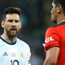 Argentina's Lionel Messi, left, complains to to referee Roddy Zambrano during a Copa America semifinal soccer match at Mineirao stadium in Belo Horizonte, Brazil, Tuesday, July 2, 2019. (AP Photo/Victor R. Caivano)